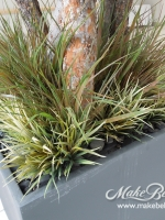 mixed_grasses_and_river_rock_base_planting