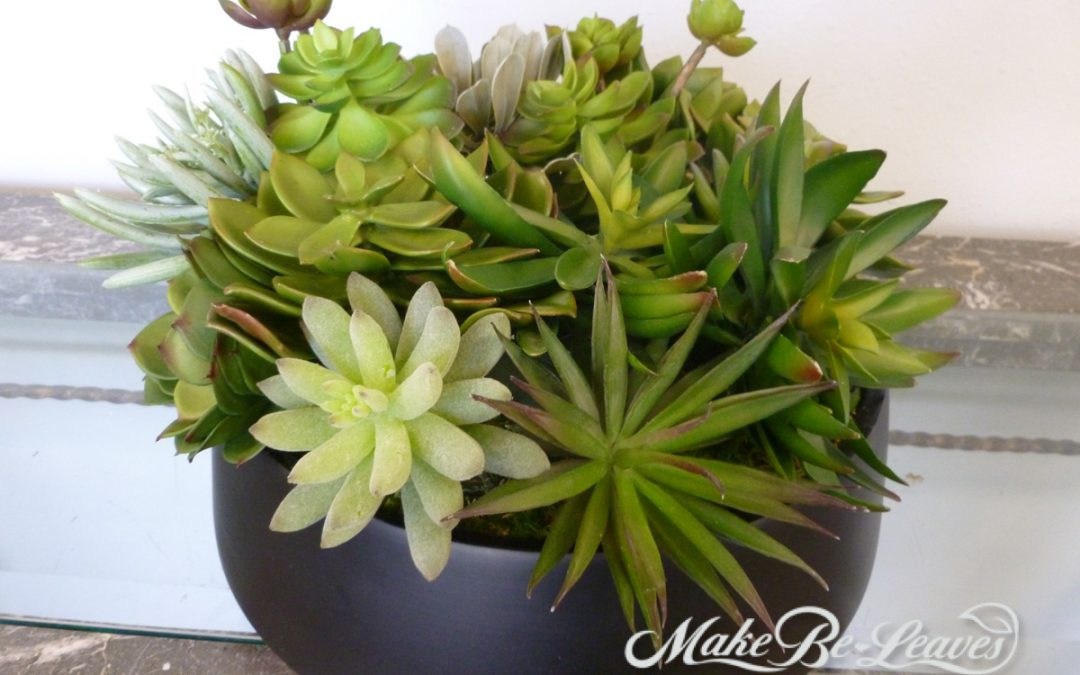 Custom faux succulent arrangements for luxury department stores