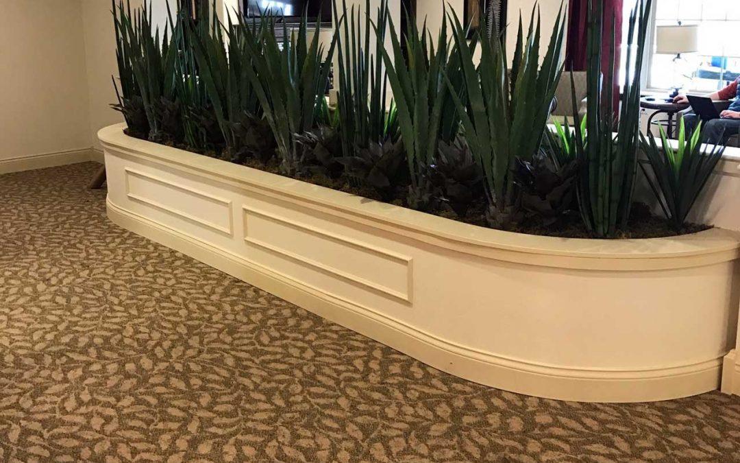 Artificial plants beautify the Primrose Retirement Community interior design